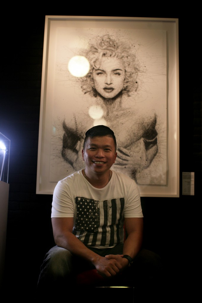 EXUBERANT: Vince Low poses in front of his Madonna piece at The Connoisseur Concerto where his exhibition will be held till June 2.