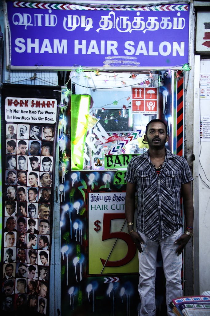 HARD WORK: Steven John standing proudly in front of his barber joint.